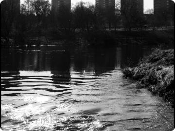 Tower blocks reflected in the River Don.