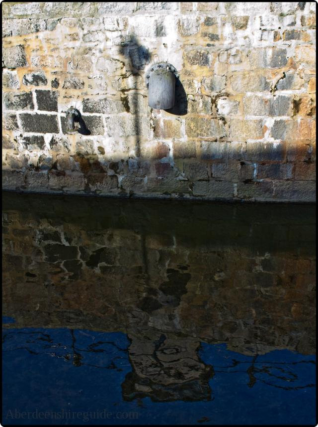 Reflection of mill pipework.